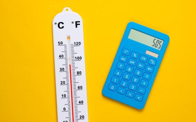 Termometr pogodowy i kalkulator na żółto