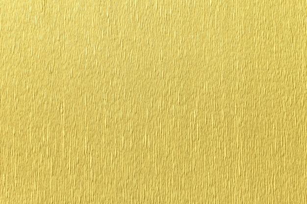 Textural złoty tło falisty gofrujący papier, zbliżenie.