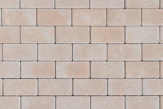 Textured kamiennej ściany ceglanej tekstury abstrakcjonistyczny tło piaskowcowa fasada