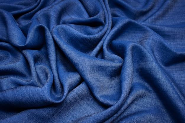 Tkanina bawełniana. dżinsy ciemnoniebieski kolor. tekstura,