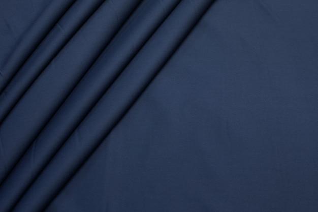 Tkanina bawełniana. kolor jest szaro-niebieski. tekstura,