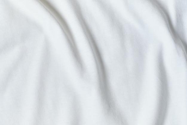 Tkanina jedwabna w kolorze białym jako tło i tekstura