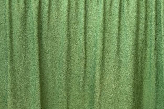 Tkanina karbowana w kolorze zielonym. abstrakcyjne tekstury