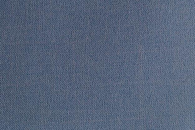 Tkanina poliestrowa w kolorze indygo, tekstura i tło tekstylne.
