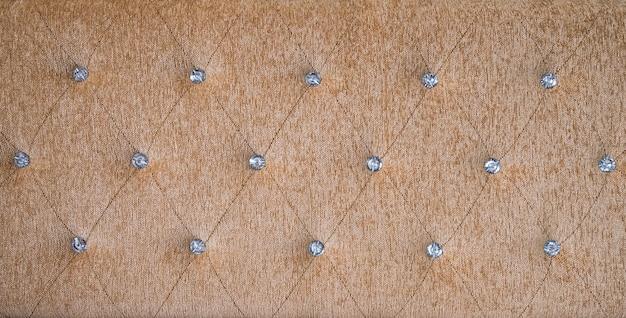 Tkanina tapicerska brązowa sofa lub tekstura wezgłowia