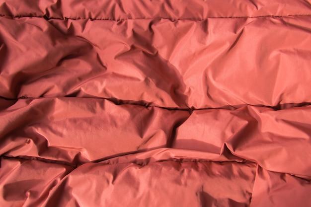 Tkanina teksturowa. tło włókienniczych brązowej dzianiny.