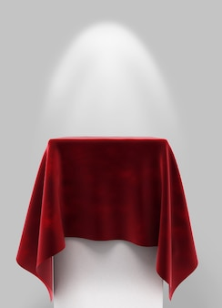 Tkanina welurowa w kolorze czerwonym na cokole kwadratowym na szarym tle z podświetleniem