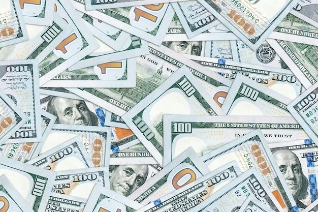 Tło 100 dolarowych. tekstury pieniędzy. kilka tysięcy amerykańskich dolców.