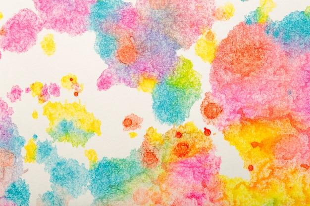Tło akwarelowe kolorowe pociągnięcia pędzlem akwarelowej farby na białym papierze wysokiej jakości zdjęcie