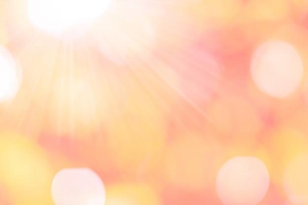 Tło bokeh z różowym, pomarańczowym światłem słonecznym do wykorzystania jako walentynki lub miłości.
