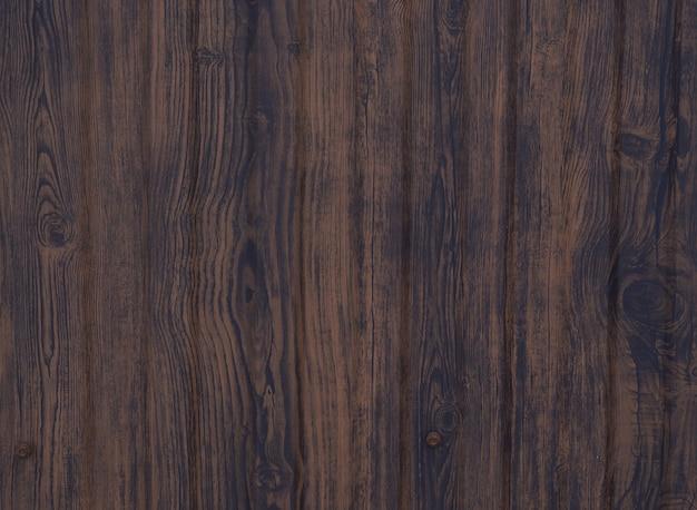 Tło brązowe deski drewniane, tekstura drewna z sękami