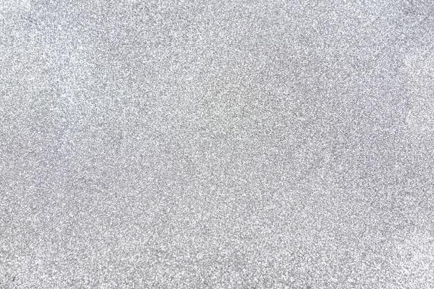 Tło brokat srebrny błyszczące tło boże narodzenie. tło wzór światła świecidełka. srebrny i biały.