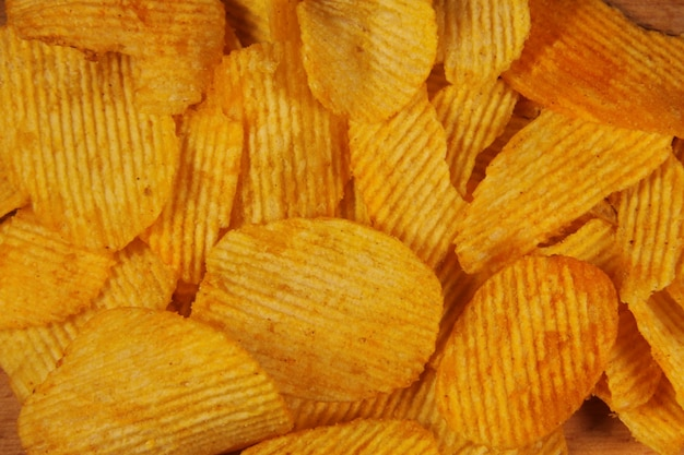Tło chipsy ziemniaczane