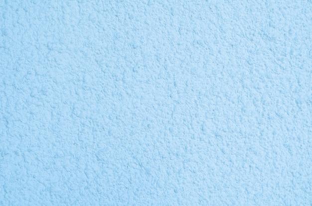 Tło ciemnoniebieskiego stiuku powlekanego i malowanego na zewnątrz