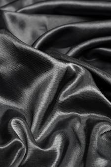 Tło czarne tkaniny jedwabne