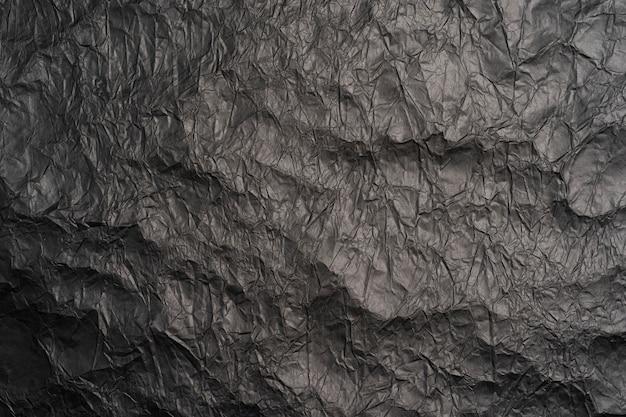 Tło czarny zmięty papier tekstury