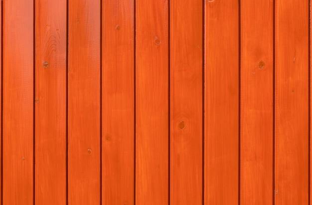 Tło drewna. deski lakierowane na pomarańczowo.