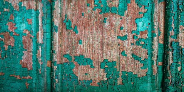 Tło drewniana deska z pękniętą farbą. struktura drewna color-peel.