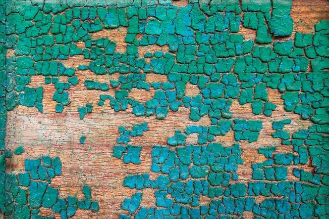Tło drewniana deska z pękniętą farbą. struktura drewna color-peel