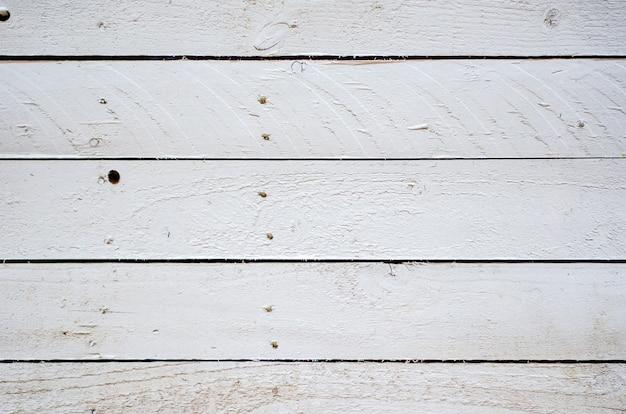 Tło drewniana stara biała tekstura. zbliżenie na poziome deski.