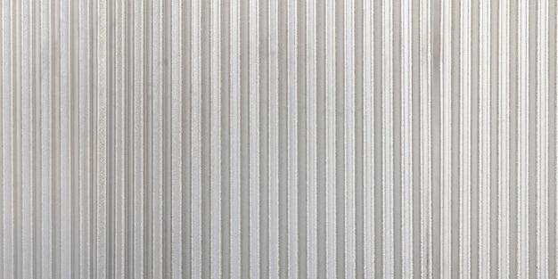 Tło falistej metalowej panoramy ściany szary. rusty cynk grunge tekstury i tła.