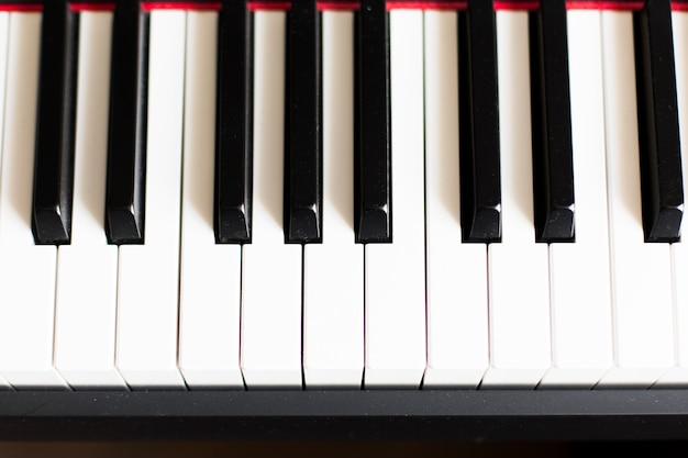 Tło fortepianu lub syntezatora elektronicznego (klawiatury fortepianu)