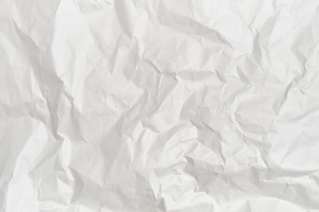 Tło i tekstura białego zmiętego papieru.