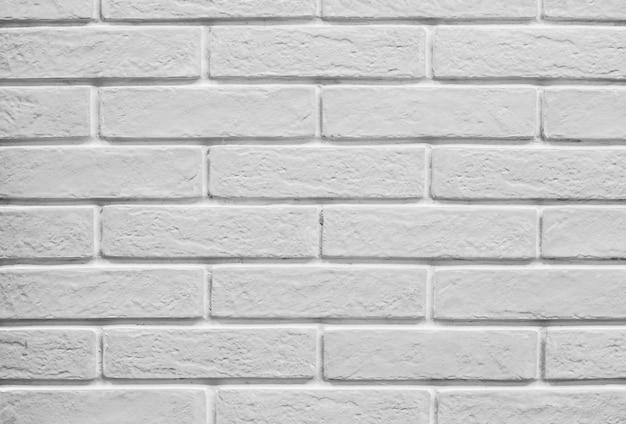 Tło i tekstura dekoracyjna biała ściana z cegły