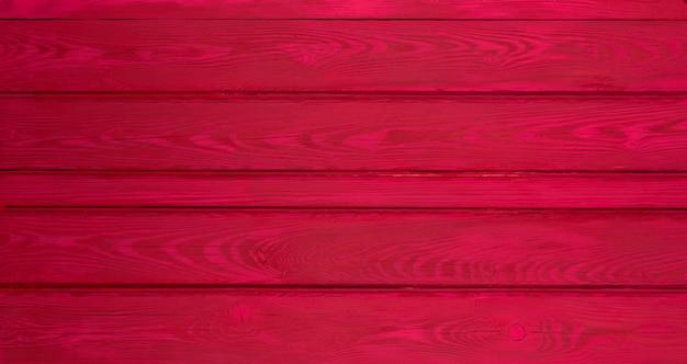 Tło i tekstura dekoracyjna czerwona drewniana ściana stodoły