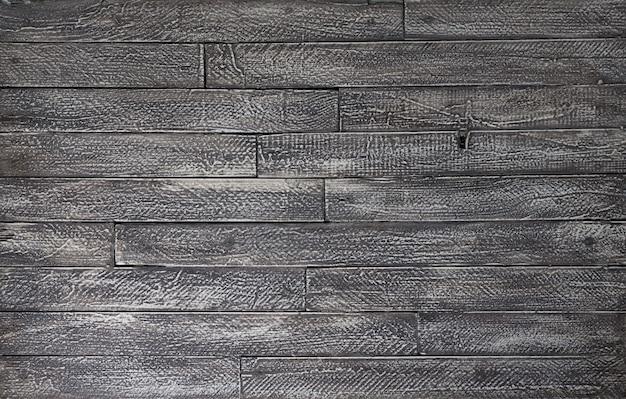 Tło i tekstura dekoracyjnej czarnej drewnianej ściany stodoły