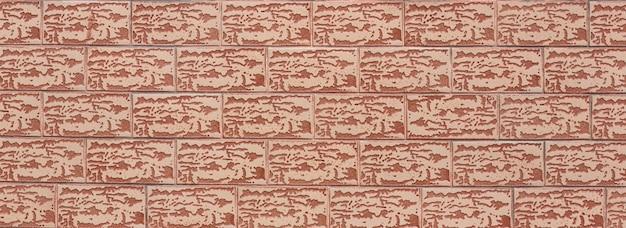 Tło i tekstura dekoracyjny brązowy mur z cegły