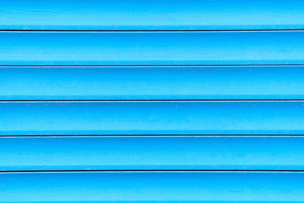 Tło i tekstura metal bramy w błękicie