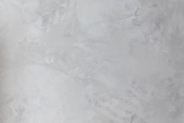 Tło i tekstura ściany betonowej pomalowanej farbą w kolorze szarym