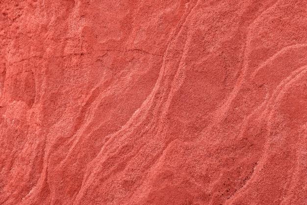 Tło i tekstura w koralowym kolorze, naturalna piaskowiec powierzchnia - wizerunek