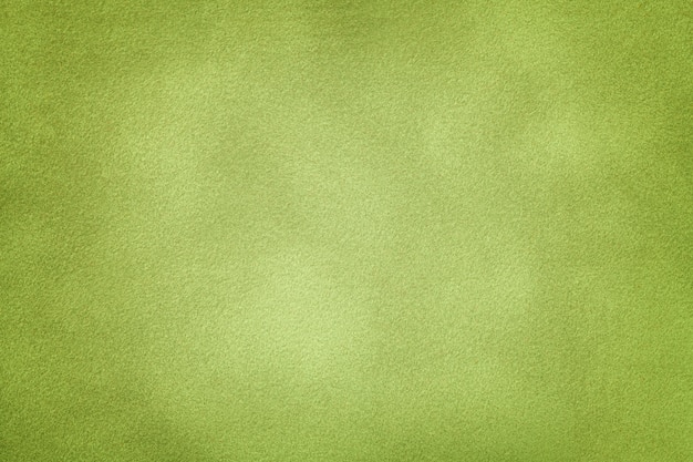 Tło jasnozielony zamszowy tkaniny zbliżenie.