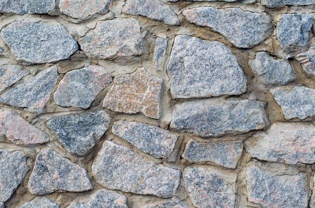 Tło kamiennej ściany okładziny tekstury, brązowe kamienne cegły