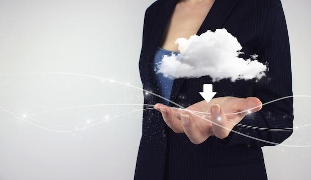 Tło koncepcji zintegrowanej sieci cyfrowej. ręka trzymać hologram cyfrowy chmura na szarym tle.