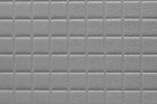 Tło kwadratów z miękką teksturą, metaliczny szary kolor ściany książki notebooka