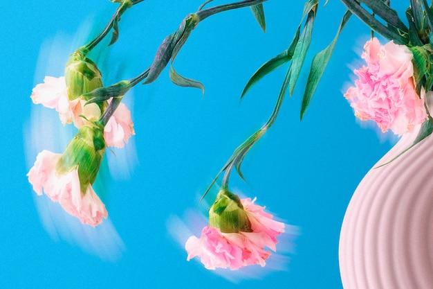 Tło kwiatowe, niebieska sztuka goździków