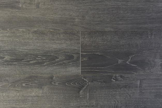 Tło laminowane. drewniane laminowane i parkietowe deski podłogowe w aranżacji wnętrz. tekstura i wzór naturalnego drewna