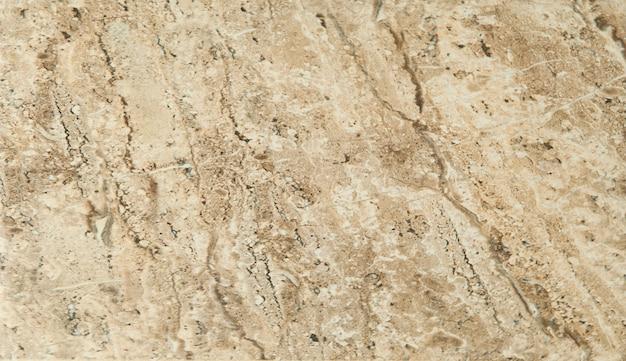 Tło marmurowego wzoru brązowego trawertynu