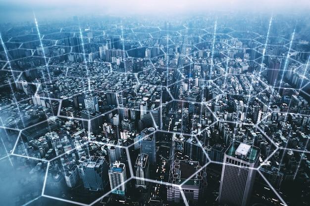 Tło miasta taipei o zmierzchu na tajwanie z holograficznymi sześciokątami