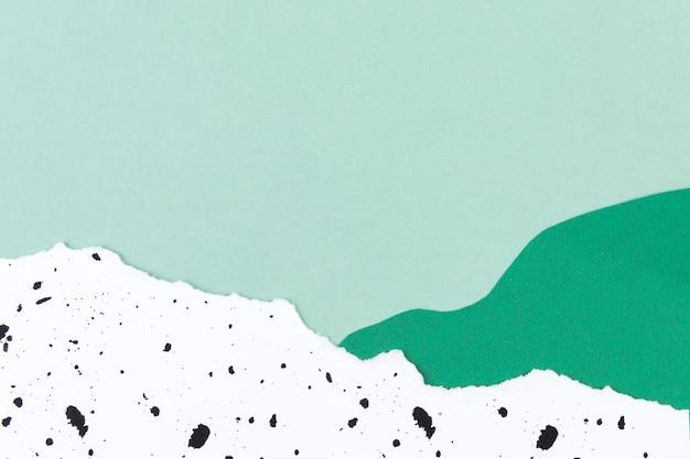 Tło natury z kolażem z zielonej góry papieru