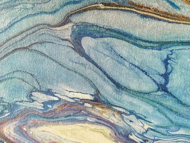 Tło niebieskie plamy farby. fragment dzieła sztuki