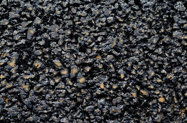 Tło nowej i świeżej czarnej smoły asfaltowej