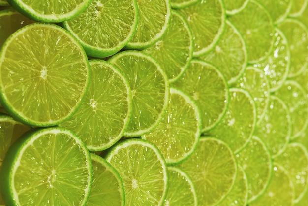Tło plasterki świeżej limonki.