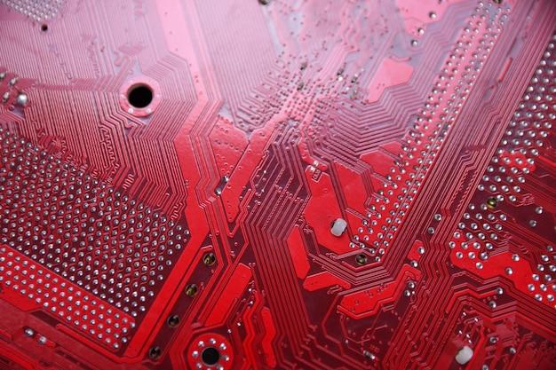 Tło płyty głównej komputera i komponenty elektroniczne cpu pamięć gpu i różne gniazda karty graficznej z bliska