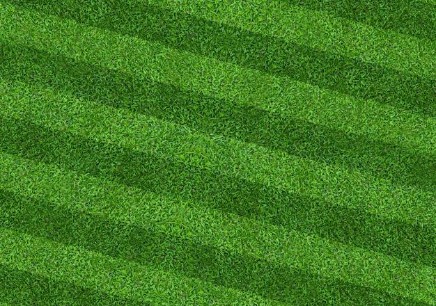 Tło pola zielonej trawy dla sportu piłki nożnej i piłki nożnej. zielony trawnik wzór i tekstura tło. zbliżenie.