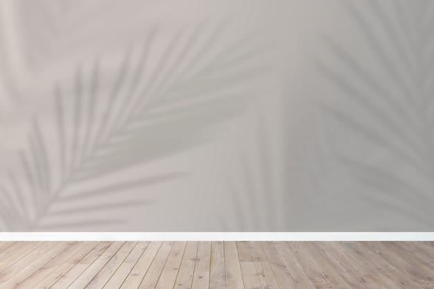Tło produktu, pusta drewniana podłoga z cieniem tropikalnych liści