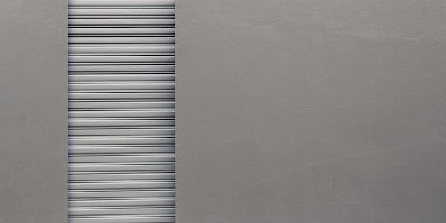 Tło ściana ulicy. brama rolowana i posadzka betonowa na zewnątrz budynku fabrycznego dla przemysłu